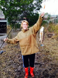 Kelsey Claiborne, of Wilmington, with a puppy drum that bit shrimp under a slip float in a Sneads Ferry creek while she was fishing with Brent Hinson.
