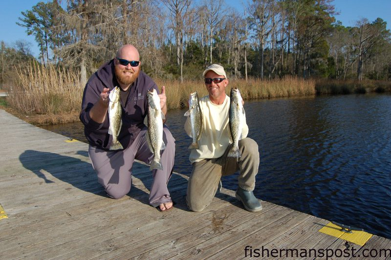 Joshua Alexander and Capt. Ricky Kellum, of Speckled Specialist Charters, with a brace of speckled trout that struck soft plastic baits while they were fishing the Neuse River near New Bern.