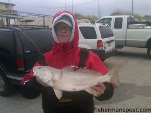 Jake Worthington (age 15), of Camden, NC, with a puppy drum he hooked in the Frisco surf.