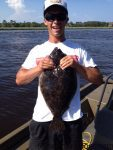 Tyler Chabot, of Kure Beach, with a 6 lb. flounder that bit a soft plastic bait in Snow's Cut. Weighed in at Kure Pier.