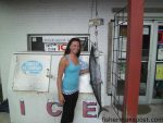 Kristina Steenborg, of Southport, NC, with a 31 lb. king mackerel that struck a live menhaden beneath a kite off Oak Island.