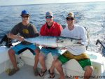 Casey and Taylor Miller and Drew Wilkinson with a citation 45.3 lb. wahoo that bit a skirted ballyhoo near the 100/400 while they were fishing with Mike Miller.