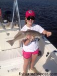 Kate Thomas, from GA, with a red drum that struck a chunk of blue crab in the Sunset Beach bridge canal while she was fishing with Capt. Mark Dickson of Shallow Minded Inshore Fishing Charters.