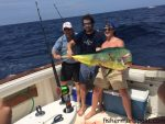 """Frank Johnson, Capt. Brody Heath, and the crew of the """"Emma Rose"""" earned first place in the 2014 Far Out Shootout by pairing this 28.5 lb. dolphin with a 39.1 lb wahoo for a 67.6 lb. aggregate. Their fish bit ballyhoo paired with glass head trolling lures near the Blackjack Hole."""