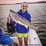 """Megan Gerrell with a 28"""" red drum she caught and released in Broad Creek off the Neuse River while fishing with shrimp."""