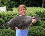 Web Eckel (age 9) with a 4+ lb. flounder he hooked on a live finger mullet off his dock at Wrightsville Beach.