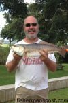 """Tim Johnson, of Ocean, NC, with a 27"""" red drum that bit a Betts Halo Shrimp off his Bogue Sound dock."""