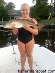 """Makala Hall (age 12), of Archdale, NC, with her first red drum, a 25"""" fish that bit a live finger mullet while she was fishing Davis Creek on her borther's boat."""