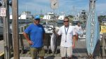 """Pat and Matthew Kelly, of Chesapeake, VA, with a pending NC State Record skipjack tuna. The pair hooked the 32 lb. fish while trolling off Hatteras Inlet on the """"Megabite."""" Weighed in at Teach's Lair Marina."""