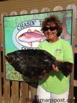 Rachel Morgan, of Beaufort, NC, with a 7.23 lb. flounder that bit a live fiddler crab near the Morehead port wall. Weighed in at Chasin' Tails Outdoors.