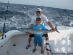 """Ricahrd and Connor Mcinnis, of Rockingham, NC, with Connor's first offshore fish, a wahoo that he landed while trolling offshore of Hatteras Inlet with on the """"Hatteras Fever II"""" with Capt. Buddy Hooper."""