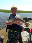 """Bryson Mayo with his first speckled trout, an 18"""" fish that inhaled a live bait on a Carolina rig near Carolina Beach Inlet."""