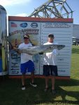 """Mark Jones and Alan Harris with the 50.14 lb. king mackerel that secured first place in Leg 2 of the Cape Lookout Shootout King Mackerel Series for the """"Miss Teny"""" crew. The big king struck a 2 lb. bluefish near the George Summerlin Reef while they were fishing with Ashley Jones and Randy Chase."""
