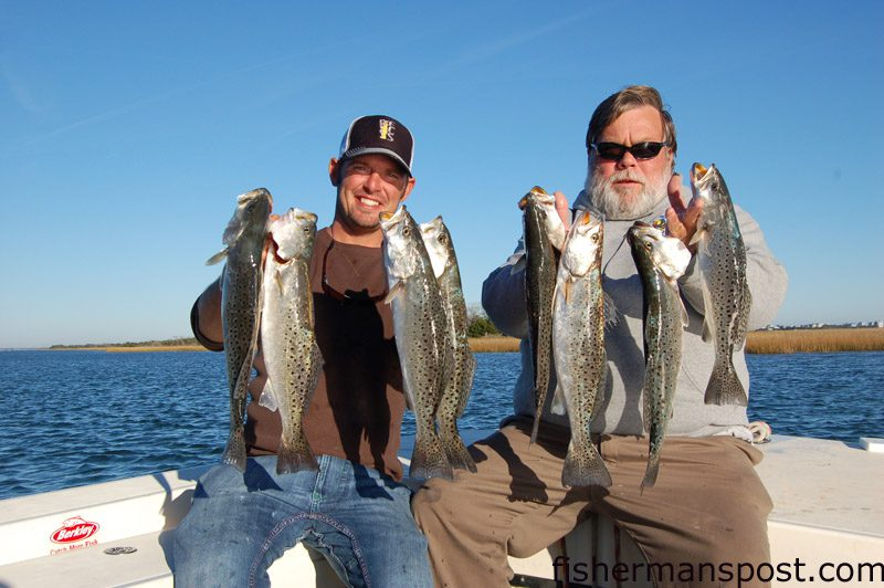 """Capt. Wayne Crisco, of Last Resort Charters, and Capt. Jodie Gay, of Blue Water Candy Lures, with two limits of 18-20"""" speckled trout that fell for Back Water Candy soft plastics and live shrimp at some ICW structure south of Surf City."""